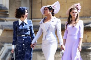 Abigail Spencer and Priyanka Chopra arrive for the wedding ceremony of Britain's Prince Harry, Duke of Sussex and US actress Meghan Markle at St George's Chapel, Windsor Castle, in Windsor, on May 19, 2018. (Credit: CHRIS JACKSON/AFP/Getty Images)