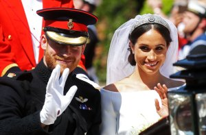 Meghan, Duchess of Sussex begins her carriage procession with Britain's Prince Harry, Duke of Sussex in the Ascot Landau Carriage after their wedding ceremony at St George's Chapel, Windsor Castle, in Windsor, on May 19, 2018. (Credit: CHRIS JACKSON/AFP/Getty Images)
