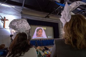 People and students at Immaculate Heart High School and Middle School in Los Angeles gather to view a live broadcast of the wedding of Meghan Markle, who graduated from Immaculate Heart in 1999, to Britain's Prince Harry on May 19, 2018. (Credit: DAVID MCNEW/AFP/Getty Images)