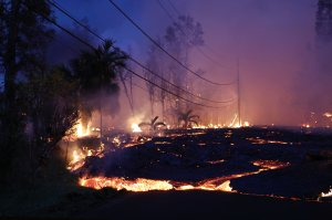 Lava from a Kilauea volcano fissure advances up a residential street in Leilani Estates, in Pahoa on Hawaii's Big Island, May 27, 2018. (Credit: Mario Tama / Getty Images)