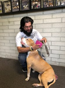 Apolonio Muñoz and Marcee the dog are reunited in this photo provided by the Downey Police Department on May 29, 2018.