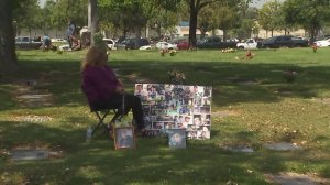 Jessie Lopez sits by her son's gravesite on May 10, 2018. (Credit: KTLA)