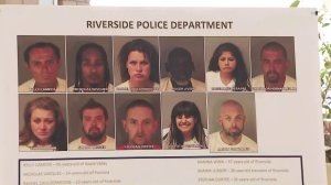 The mugshots of 11 of the suspects were displayed at a news conference in Riverside on May 29, 2018. (Credit: KTLA)
