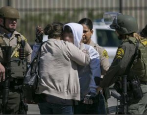 An image posted to Facebook by the Los Angeles County Sheriff's Department's Lancaster station shows two individuals hugging as officers respond to a shooting on May 11, 2018.