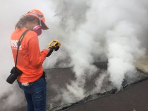 "USGS-Hawaiian Volcano Observatory geologist measured a temperature of 103 degrees C (218 degree F) at a crack along Nohea Street, Leilani Estates. The asphalt road was describes as ""mushy"" from the heat. (Credit: USGS VOLCANOES)"