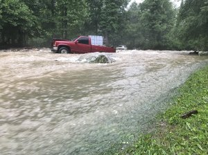 A truck is seen surrounded by floodwaters in North Carolina in May 2018 as subtropical depression Alberto wreaked havoc on the southeastern U.S. (Credit: Nathan West/Twitter via CNN)