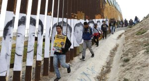 A caravan of Central American asylum seekers at the U.S.-Mexico border on April 29, 2018. (Credit: Alejandro Tamayo/San Diego Union-Tribune)