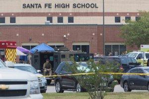 Emergency crews gather in the parking lot of Santa Fe High School where 10 people were killed on May 18, 2018 in Santa Fe, Texas. (Credit: Daniel KramerAFP/Getty Images)