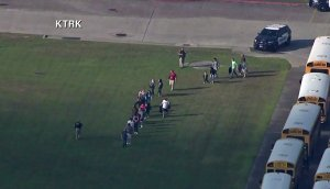 Students leave a high school campus in Santa Fe, Texas after reports of a shooting there on May 18, 2018. (Credit: KTRK via CNN)