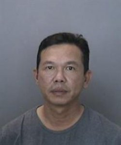 Kelven Ta, 47, is seen in a booking photo released May 3, 2018, by the Anaheim Police Department.