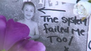 "An undated photo of Anthony Avalos with the words ""the system failed me too"" is displayed at a vigil held to remember him in Lancaster on June 22, 2018. (Credit: KTLA)"