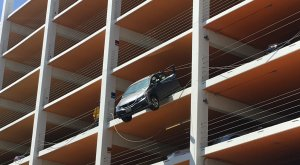 A car was dangling from a Santa Monica parking structure on June 11, 2018. (Courtesy Merle Stadnyk)