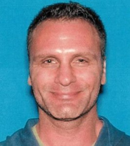 Greg Alyn Carlson is seen in a 2014 photo provided by the FBI.