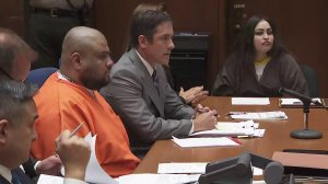 Isauro Aguirre, left, and Pearl Fernandez, right, flanked by attorneys, are shown at a sentencing hearing on June 7, 2018. (Credit: KTLA)