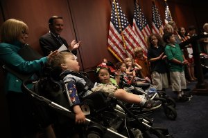 Families attend a press conference held to highlight the effects of a proposal considered by the U.S. Senate in an effort to repeal and replace the Affordable Care Act, which guaranteed coverage to patients with pre-existing conditions, at the U.S. Capitol on July 12, 2017 in Washington D.C. (Credit: Win McNamee/Getty Images)