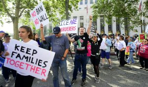 People protest in front of a federal courthouse as Attorney General Jeff Sessions visits Los Angeles on June 26, 2018. (Credit: Frederic J. Brown / AFP / Getty Images)