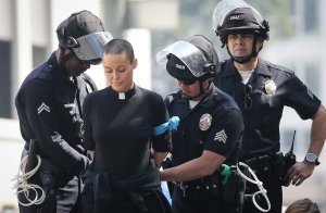 A protestor is arrested during a demonstration over a visit to Los Angeles by Attorney General Jeff Sessions on June 26, 2018. (Credit: Mario Tama / Getty Images)