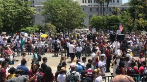 """Demonstrators take part in the """"Families Belong Together"""" march in downtown Los Angeles on June 30, 2018. (Credit: KTLA)"""