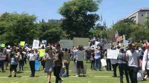 """Protesters participate in the """"Families Belong Together"""" march in downtown Los Angeles on June 30, 2018. (Credit: Erin Myers/KTLA)"""