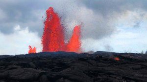 Lava from Hawaii's Kilauea volcano is seen shooting into the air in this undated photo. (Credit: USGS via CNN)