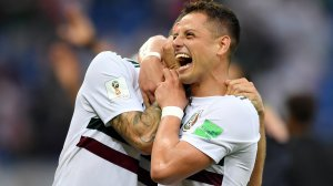Javier Hernandez and Miguel Layun of Mexico celebrate their team's victory in the World Cup match against South Korea on June 23, 2018, in Russia. (Credit: Hector Vivas/Getty Images)