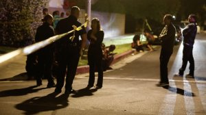 Residents stand outside the police tape after a shooting in North Hollywood on June 10, 2018. (Francine Orr / Los Angeles Times)