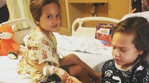 Kalea and Noah Avery hold hands as Kalea recovers at the hospital in this undated photo on the children's GoFundMe page.