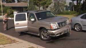 A damaged Cadillac SUV matching the description of one driven by a hit-and-run suspect who intentionally hit a police sergeant was located in Ladera Heights on June 26, 2018. (Credit: KTLA)
