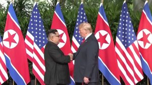 President Donald Trump and North Korean leader Kim Jong Un shake hands ahead of a summit in Singapore on June 11, 2018. (Credit: CNN)