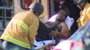 Officials wheel Gene Atkins into an ambulance after a deadly standoff with police at a Trader Joe's in Silver Lake on July 21, 2018. (Credit: KTLA)
