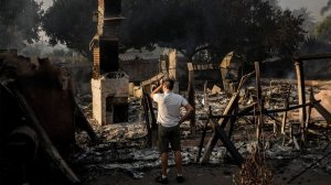 Eric Durtschi surveys the charred remains of his rental home in Goleta on July 7, 2018. (Credit: Marcus Yam/Los Angeles Times)