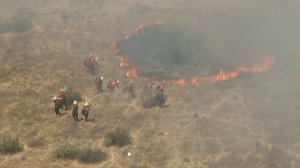 Crews worked to contain a brush fire that was burning in the Stevenson Ranch area on July 23, 2018. (Credit: KTLA)