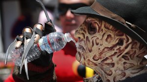 Stefano Alippi, dressed up as Freddy Krueger, cools off on Hollywood Boulevard during a heat wave in July 2018. (Credit: Mel Melcon / Los Angeles Times)