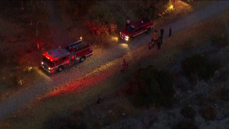 Fire officials respond to the scene where a horse fell on and injured two children in Lake View Terrace on July 10, 2018. (Credit: KTLA)