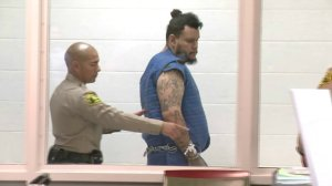 Kareem Ernesto Leiva is escorted into an Antelope Valley courtroom on July 2, 2018. (Credit: KTLA)