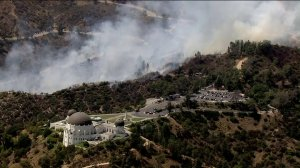 The Griffith Observatory was evacuated as a small brush fire burned precariously close to the historic building on July 10, 2018. (Credit: KTLA)
