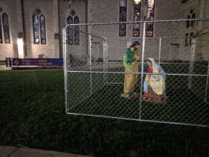 A church in Indianapolis has put up a display that shows the statues of Mary, Joseph and Baby Jesus in a cage to protest the Trump administration's 'zero tolerance' policy. (Credit: Christ Church Cathedral via CNN)
