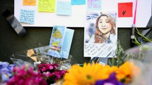 A portrait of Melyda Corado is pinned to a memorial outside Trader Joe's in Silver Lake. (Credit: Christina House / Los Angeles Times)