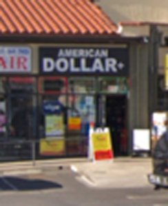 Police also released this photo of the American Dollar Plus store where the suspect worked.