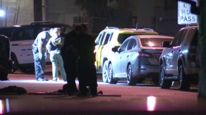 Law enforcement officials investigate a deadly shooting in Colton on Aug. 7, 2018. (Credit: KTLA)