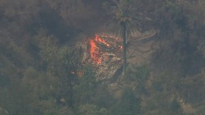 The charred remnants of what appears to be a structure can be seen in this aerial Sky5 footage of the Holy Fire, which started in the Trabuco Canyon area on Aug. 6, 2018. (Credit: KTLA)