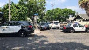 Law enforcement vehicles block a portion of 8th Street in Long Beach due to a barricade situation on Aug. 26, 2018. (Credit: Long Beach Post)