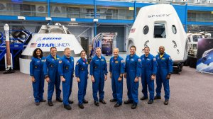 The seven men and two women will also be the first astronauts to fly in capsules developed and built by the private sector are seen in a photo released by NASA.