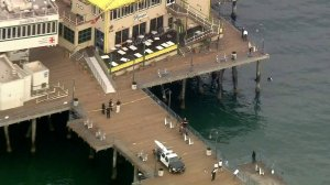 Santa Monica Police Department officials respond to a shooting at the pier on Aug. 23, 2018. (Credit: KTLA)