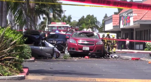 A plane crashed at a parking lot in Santa Ana and hit a vehicle on Aug. 5, 2018. (Credit: OC Hawk)