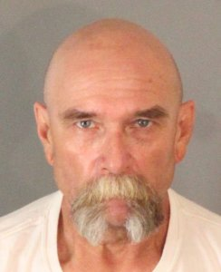John Titow, 59, is seen in a booking photo released by Riverside police on Aug. 17, 2018.