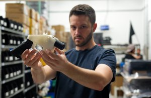 Cody Wilson, owner of Defense Distributed, holds a 3-D-printed gun called the Liberator in his Austin, Texas, factory on Aug. 1, 2018. (Credit: Kelly West / AFP / Getty Images)