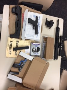 Guns and other materials that authorities say were used to illegally manufacture firearms at a home in Oxnard are seen in this photo released by the Ventura County Sheriff's Office on Sept. 20, 2018.