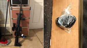 A modified assault rifle and black tar heroin seized by Los Angeles County sheriff's deputies in East L.A. are seen in images released Sept. 25, 2018, by the Sheriff's Department.
