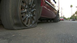 A vehicle with a slashed tire was one of 85 vehicles that were vandalized in Jefferson Park on Sept. 19, 2018. (Credit: KTLA)